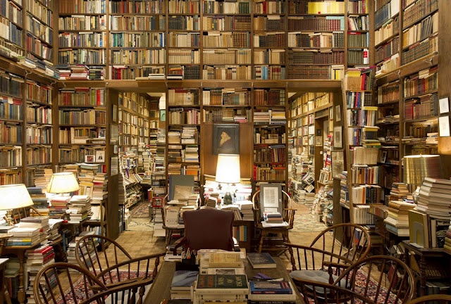 I would love my house to look like this. Every room. I'd have so many books, I could craft a living room table out of books. And then you could read while you eat.