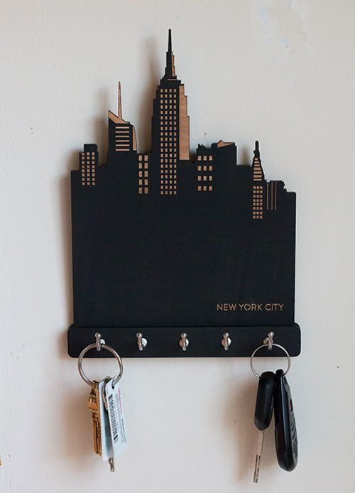 This fantastic key holder will look great in any house or apartment. It features an original NYC skyline theme and is laser-cut and engraved using maple plywood. It is then painted with chalkboard pai                                                                                                                                                                                 More