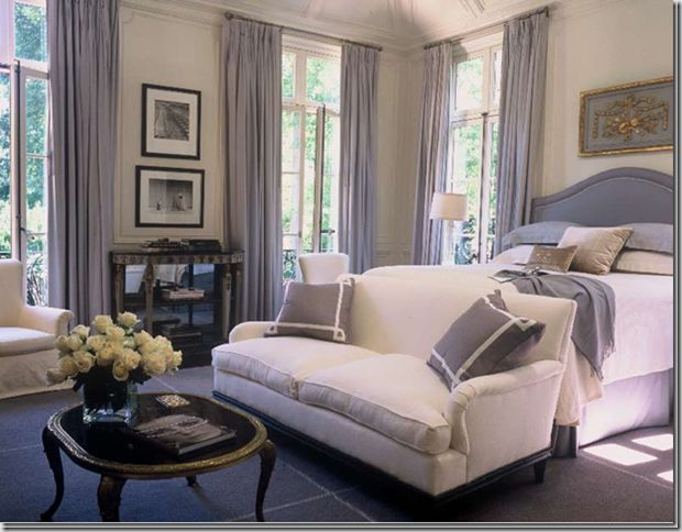 just love a couch at end of bed. Paneling + pillows