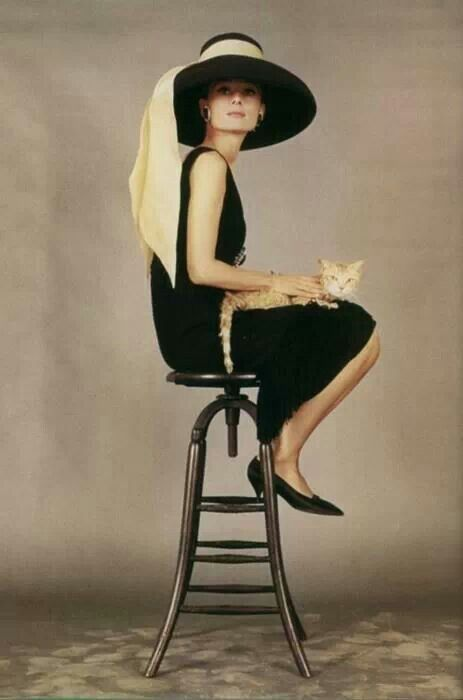 Audrey Hepburn- the golden yellow of the sash just touches the whole outfit with that certain splash of elegance.