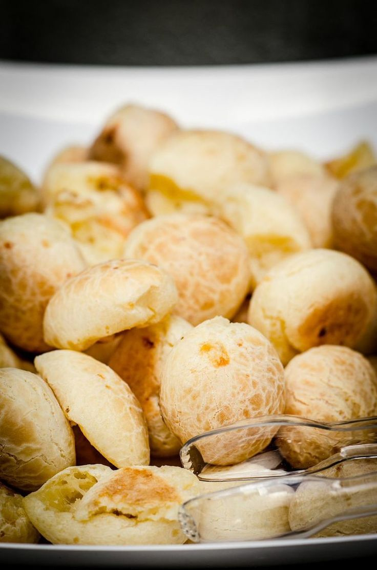 """""""Pão de queijo"""" is a small, baked, cheese roll -- a popular snack and breakfast food in Brazil."""