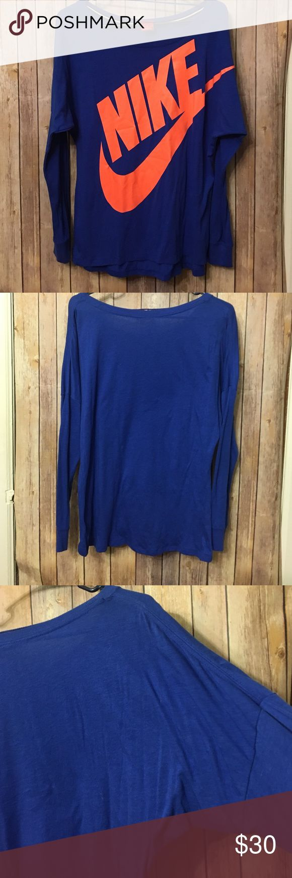 Nike off the shoulder top Off the shoulder top. Long batwing sleeves. Royal blue with orange logo. Excellent used condition. Size medium Nike Tops Tees - Long Sleeve