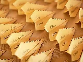 cute escort card idea, but may be tiresome to make so many paper airplanes! I like this idea for escort cards and luggage tags as favors.