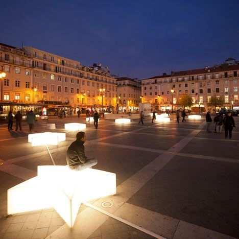 Designer Pedro Sottomayor's shining stars provide benches for tourists around Figueira Square.