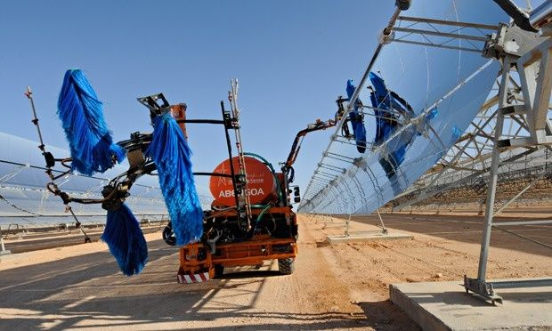 This makes me think of the Cat in the Hat type machines...  Solar Panels being cleaned at the Ain Beni Mathar Integrated Combined Cycle Thermo-Solar Power Plant in Morocco.  Photograph: Dana Smillie/World Bank