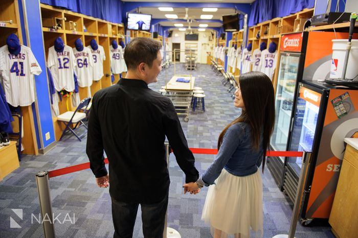Chicago Cubs Wrigley Field Engagement Photos! Creative engagement pictures for the baseball fan in the Cubs clubhouse! Chicago Engagement Photographer - Nakai Photography http://www.nakaiphotography.com