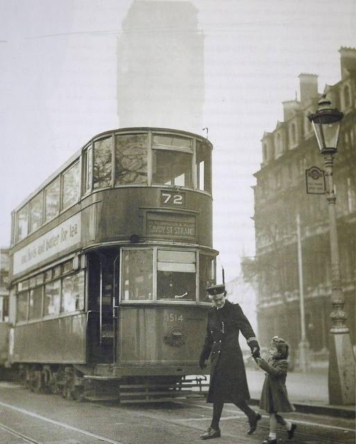 WPC Patricia Mulligan helps Cherry Couchman accross the road at Victoria Embankment c. 1950.