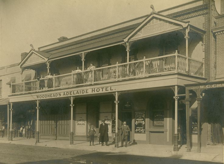 https://flic.kr/p/MeAgDe | Adelaide Hotel, Hindley Street, Adelaide, c1909 | B 8981  155 Hindley Street. Established in 1839 as the Tasmanian Hotel, then alternated between the names Prince Albert Hotel and Adelaide Hotel. Ceased trading in 1921.   Mrs Eliza Woodhead was the proprietor of the Adelaide Hotel from 1907-1913.  The family standing on the balcony is probably Mrs Woodhead,  her daughters, and her sister.  The building in 1908 (before it had the balcony) can be seen here…