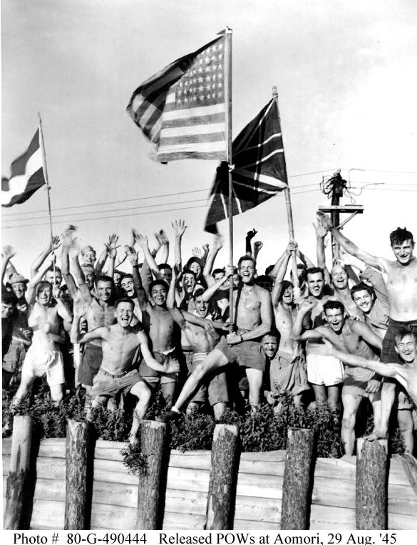 Surrender of Japan, 1945. Allied prisoners of war cheering their rescuers as…
