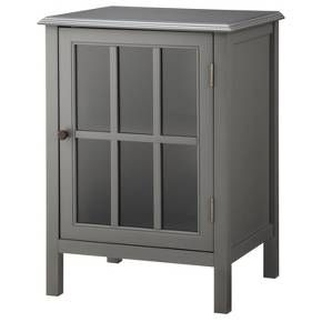 The Threshold™ Windham One Door Accent Cabinet is a classic, chic cabinet in a compact size. The elegant glass door displays decorative items and creates an air of timeless style. The adjustable shelf also gives practical storage options. Not only is this cabinet prefect for a loft or studio, it will also fit in a bathroom or paired with other pieces of the Windham collection in larger rooms. With a contemporary design and distinctive color, this small unit brings a lot of character....