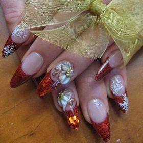 nail-art-natale-unghie-a-stiletto-rosse.jpeg (280×280)