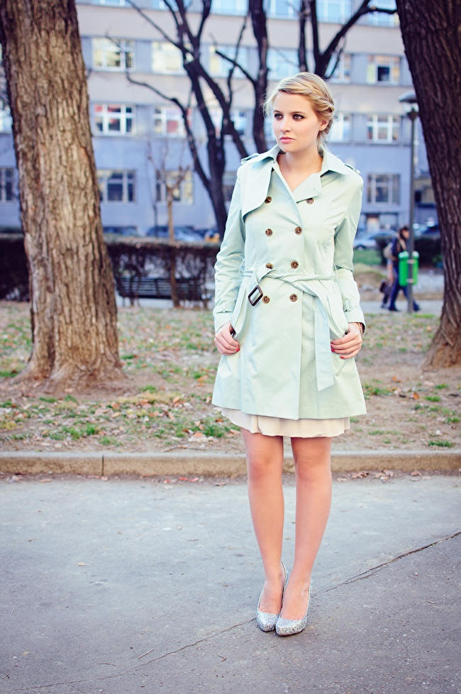 love this soft look. mint green trench coat with nude dress. love the sparkle heels.