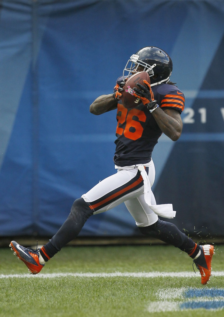Chicago Bears cornerback Tim Jennings scores after an interception against the Carolina Panthers. Week 8 2012 Season