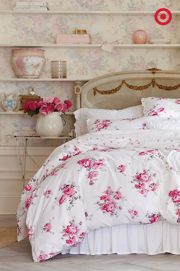 Muted wallpaper and rows of shelves strike the right balance with this Simply Shabby chic rose bedding.