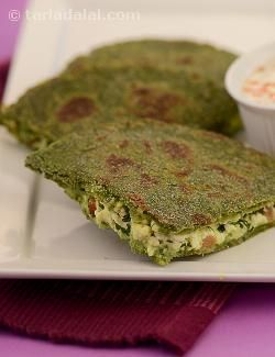 Nutritious bajra and methi rotis stuffed with delicately spiced mixture of paneer and tomatoes. Both bajra and methi are iron rich with a wealth of fibre too. Paneer is a rich source of protein and calcium. Preferably, use fresh home-made paneer made with low calorie milk. If you wish, do not fill the parathas and just make the jowar and methi rotis. . . They are yummy on their own too.