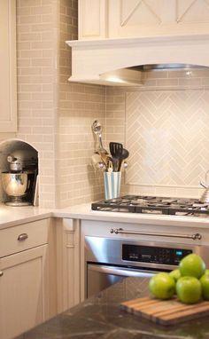Subway tile backsplash -- Traditional laying throughout, herringbone pattern above stove.