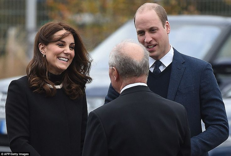 Pleased to meet you! Four-months-pregnant Kate looked to be in excellent spirits as she and William meet the Lord-Lieutenant of the West Midlands John Crabtree on the first leg of their whistlestop tour of the city on Wednesday