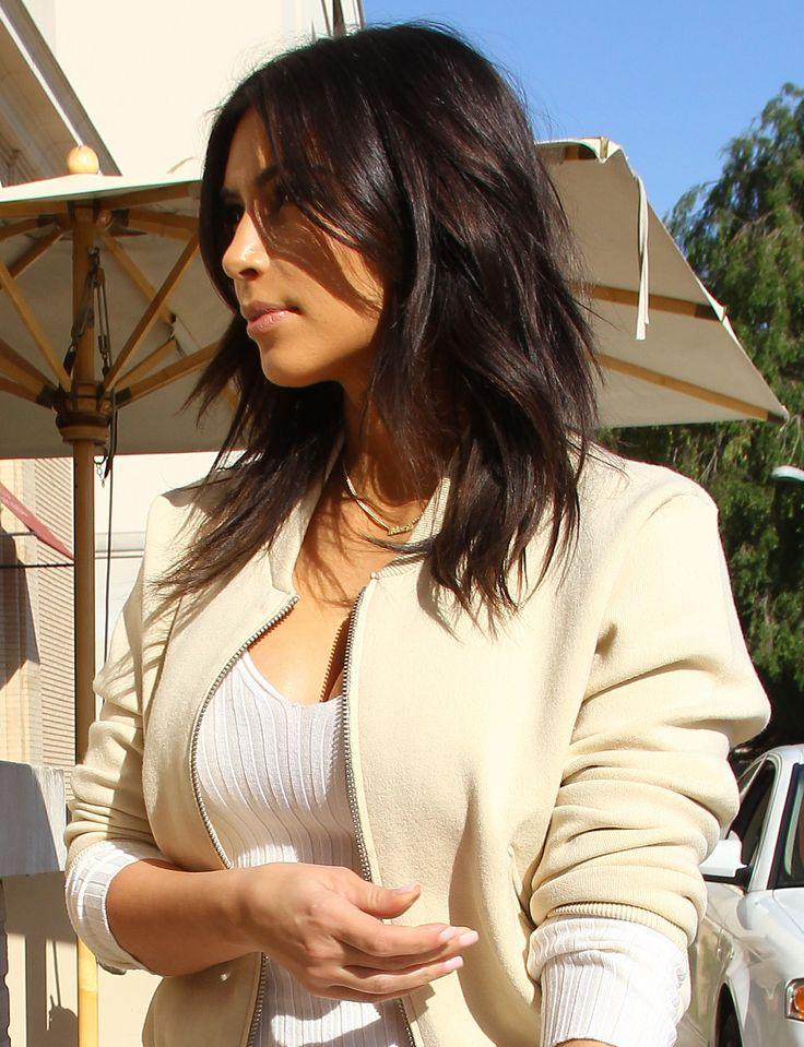 Kim Kardashian gets a shaggy new layered haircut.