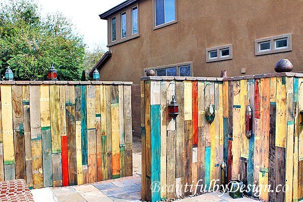 Distant shot of two sections of the diy fence made from for Diy pallet privacy fence