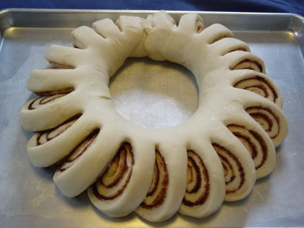 Christmas cinnamon roll wreath. Frosting in the middle for pull apart and dip