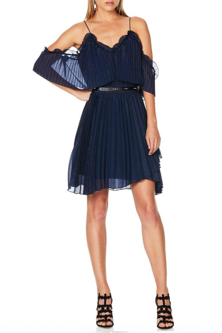 This beautiful midnight blue mini dress from Talulah has a subtle metallic weave going through the fabric and an elegant off the shoulder neckline.This fluid style has a V-neckline with a feather-light overlay panel that cascades to create a cropped fluted sleeve, with a leather and metallic hardware waist band, from which the wrap effect skirt flows. It has an invisible zip up the centre back. It is the perfect dress for a magical night out.   Pleated Wonder Mini by Talulah. Clothing…