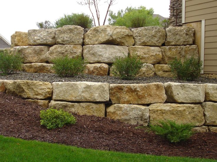 Retaining wall rock hard landscape supply landscaping for Rock wall garden designs