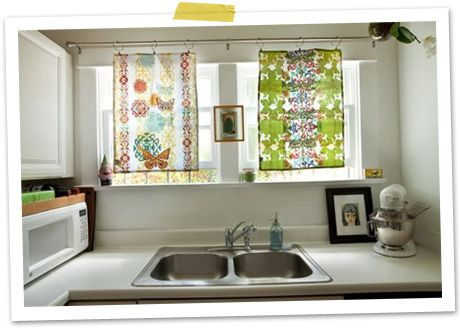 Tea Towel Curtains ok not miss matched tea towels but neat idea for rod to be able to quick change kitchen curtains for each season..