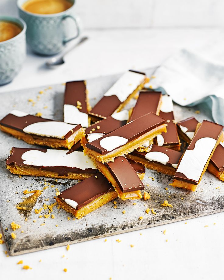 Martha Collinson's millionaire slices are made with a crumbled biscuit base instead of traditional shortbread making them much quicker to put together. Layered with malted caramel and a chocolate top these are the perfect afternoon tea treat.