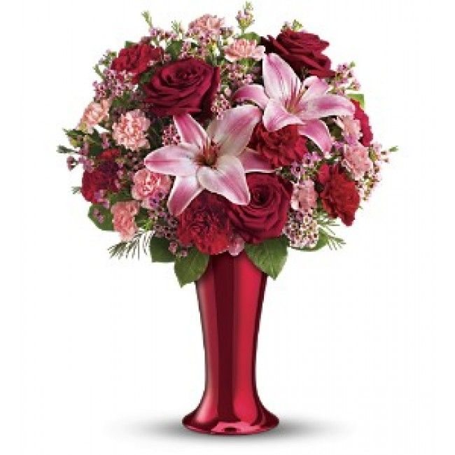Delivered in a tapered contemporary ceramic vase coated with a bright red vacuum-metallized finish.