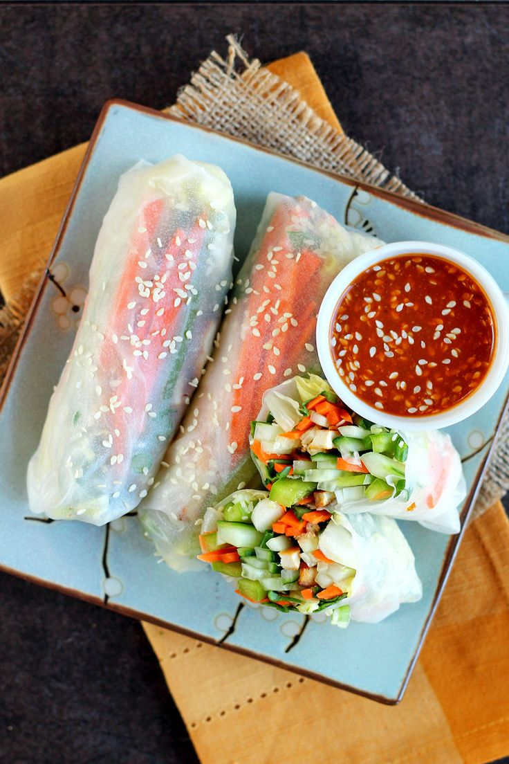 THESE are perfect appetizers to prep your meal with your guests! Let me  know how you like them!  INGREDIENTS      * ½ red pepper, julienned     * 1 large carrot, julienned     * ⅓ -1/2 long English cucumber, julienned     * 3 green onions, thinly sliced on a diagonal     * small handful of baby spinach, gently bunched up and sliced thinly     * ½-tofu     * sesame seeds     * 5-10 rice wrappers (I used 22 cm papers)  Almond Butter Sauce:      * 2 tbsp soy sauce (or Bragg's Liquid Aminos…