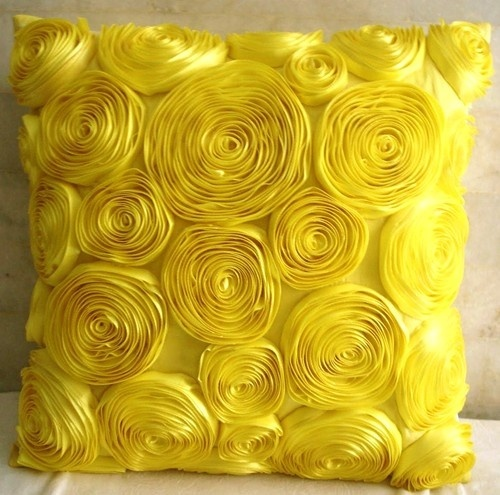 A frilly yellow pillow will add feminine charm to any space.