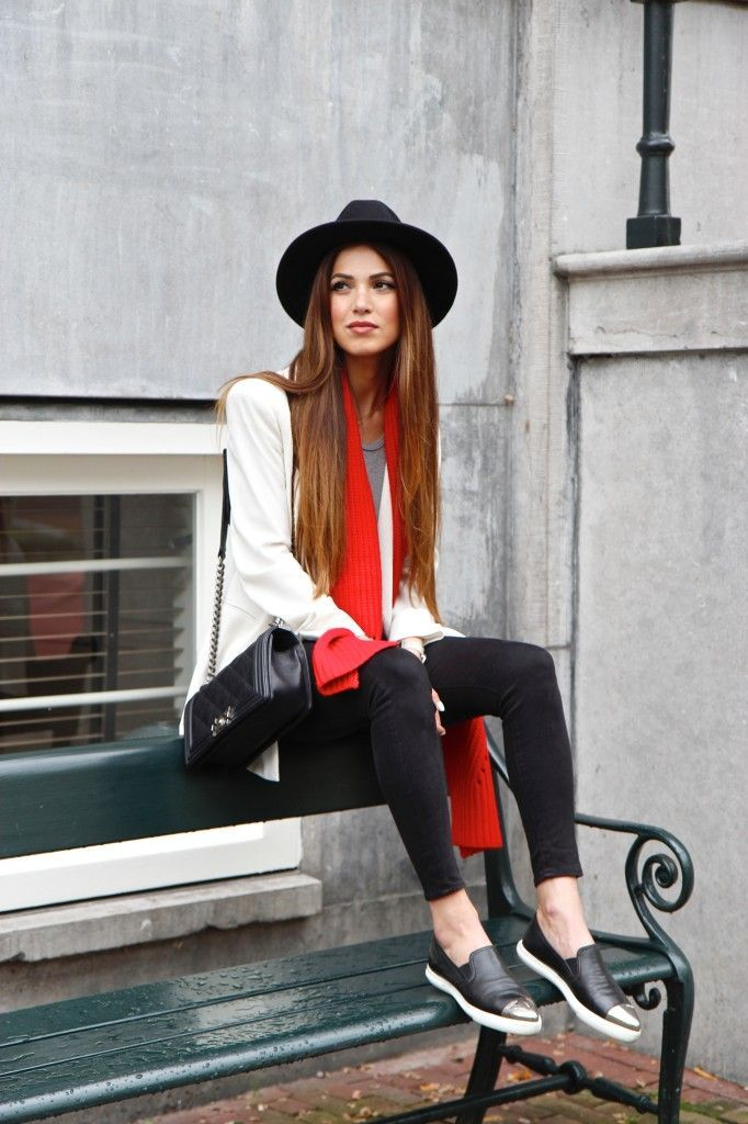 Negin Mirsalehi Is Wearing Black Skinny Jeans From River Island, White Blazer From ASOS, Slip Ons From Miu Miu And Boy Bag From Chanel
