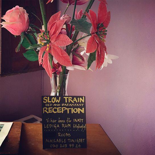 Slow Train B&B, Fårö, Gotland, Sweden. flower sign pink