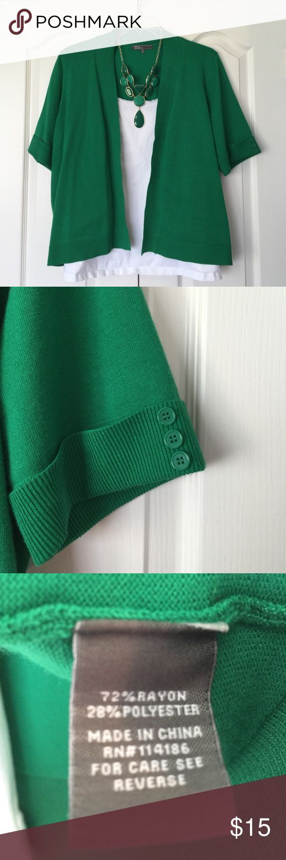 Kelly green short sleeve self closure cardigan Kelly green short sleeve self closure cardigan. Close up of buttons on sleeves. Fabric content shown in picture 3. Back shown in picture 4. 89th & Madison Sweaters Cardigans