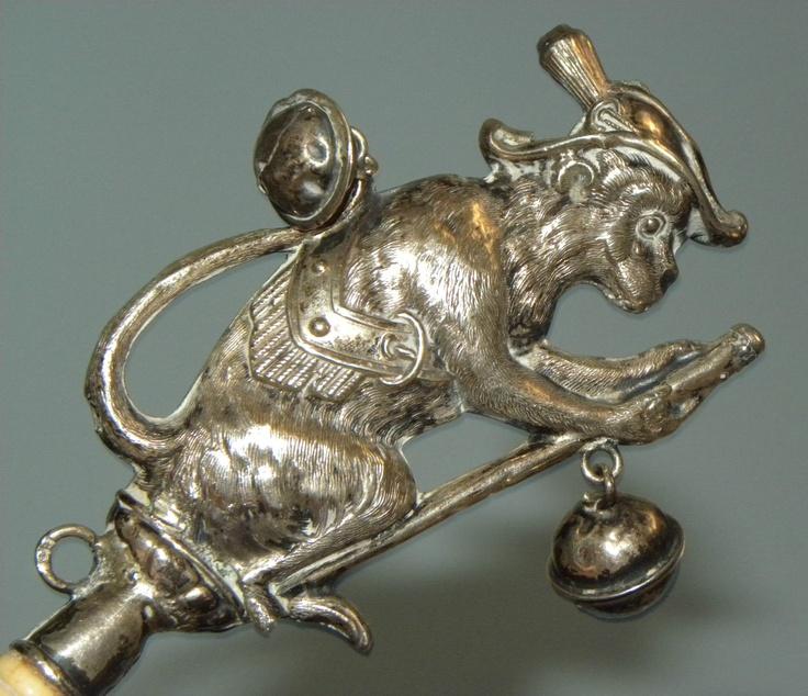 antique 'Organ Grinder's Monkey' sterling silver baby rattle