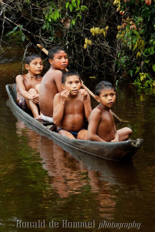 Viriunaveteri, Venezuela. Yanomami indians on the casiciare river ..The village of Viriunaveteri consists of 15 huts around a muddy square. It's situated in the Venezuelan Amazone several days by boat from the nearest town. This community on the banks of the Casiquiare is one of the few Yanomami villages that actually has some contact with the outside world. Most other tribes live deeper in the jungle. Photo: Ronald de Hommel