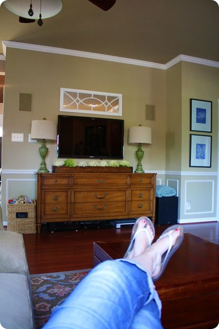 Decorate around a flat screen - I want my tv at eye level, not up over the fireplace.