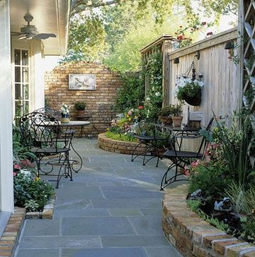 Liked on Pinterest: Nice patio & raised gardens - even a small irrigular shaped lot has potential and lots of appeal