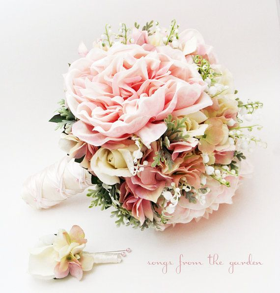 Romantic and elegant, this bridal bouquet includes lily of the valley, real touch roses & peonies and silk hydrangea in shades of pink and