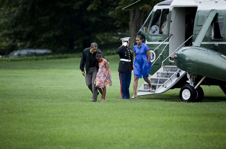 Michelle Obama Photos - (AFP OUT) President Barack Obama with daughter Sasha Obama and first lady Michelle Obama walks from Marine One on the South Lawn of the White House August 15, 2010 in Washington, DC. President Obama was returning from the Gulf Coast where he stayed in Panama City Beach, Florida with first lady Michelle Obama and their daughter Sasha for an overnight trip to the region which has been affected by the BP oil spill from the sinking of the Deep Water Horizon drilling…