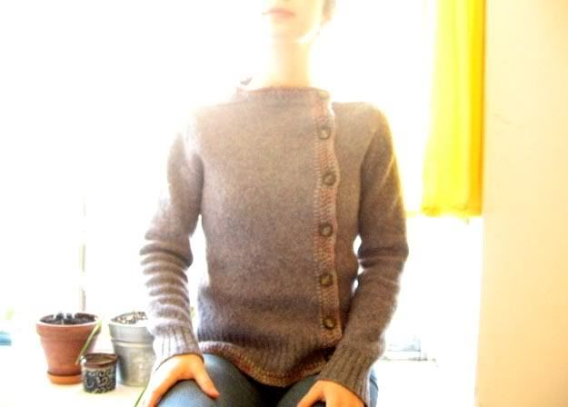 """taking the cue from emmas lookbook.... __ Recycled, reconstructed felted sweater, by """"anemone"""":  """"wash and dry at high heat to shrink and felt it up, slice down the front to make it a cardigan, then blanket stitch the border, crochet the overlap, add buttons."""""""