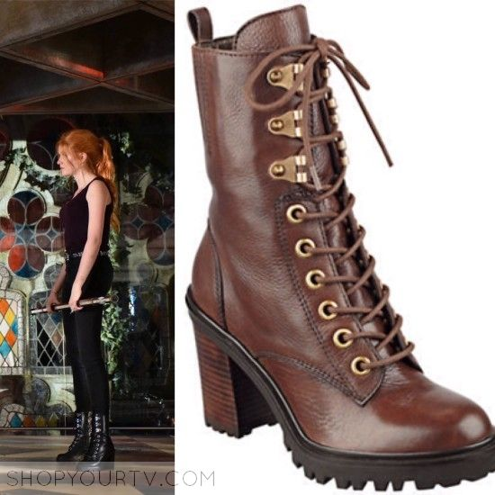 Clary Fray (Katherine McNamara) wears these black lace-up boots in this episode of Shadowhunters. They are Guess GandyLace-Up Booties. Buy them HEREfor$168.95