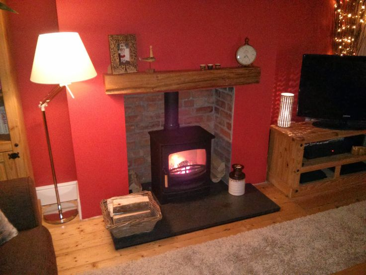 Another Chanwood C5 installed into repointed fireplace. We fitted an aged oak beam to finish off this transformation.