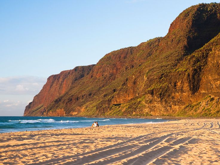 """Polihale Beach, Kauai Located at the end of a long, unpaved dirt road off Kaumuali'i Highway, Polihale Beach is often overlooked in favor of the more accessible beaches at Poipu and Kalapaki. Which is a shame—sprawled over 17 miles, it's the longest stretch of beach in Hawaii and arguably one of the most beautiful, backed by 100-foot sand dunes and framed by the Na Pali cliffs. From its silvery sands, you can even spot the """"forbidden"""" Hawaiian island of Niihau."""