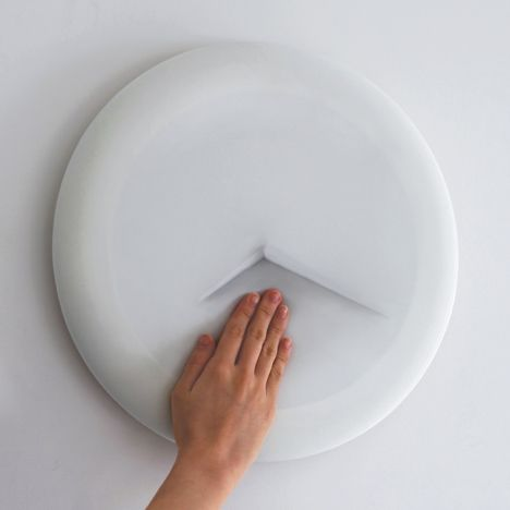 Vague Clock by Sejoon Kim (users have to feel the flexible face to reveal the time.) Renée