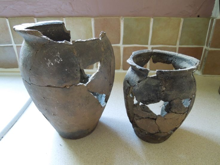 Roman Greyware oyster pot...small drain hole in lower pot for draining cleaning water.