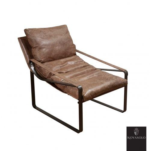 """Retroinspirert og behagelig Old Amsterdam lenestol / liggestol! Dette er en stol av høy kvalitet for deg som er ute etter noe litt utenom det vanlige!   Stolen er produsert av """"vintage skinn"""" og har rammeverk i pulverlakkert metall."""