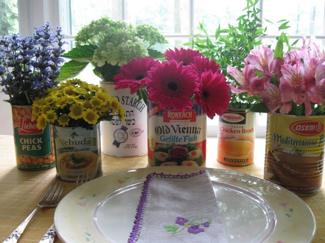Flowers in old vegetable cans would be so pretty for a garden-themed party or a rustic bbq