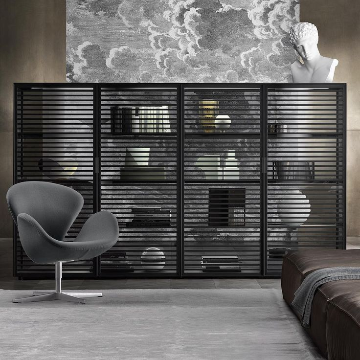 middle room alambra cabinet with black aluminum frame doors and shelves in transparent gray glass equipped with integrated led lighting system