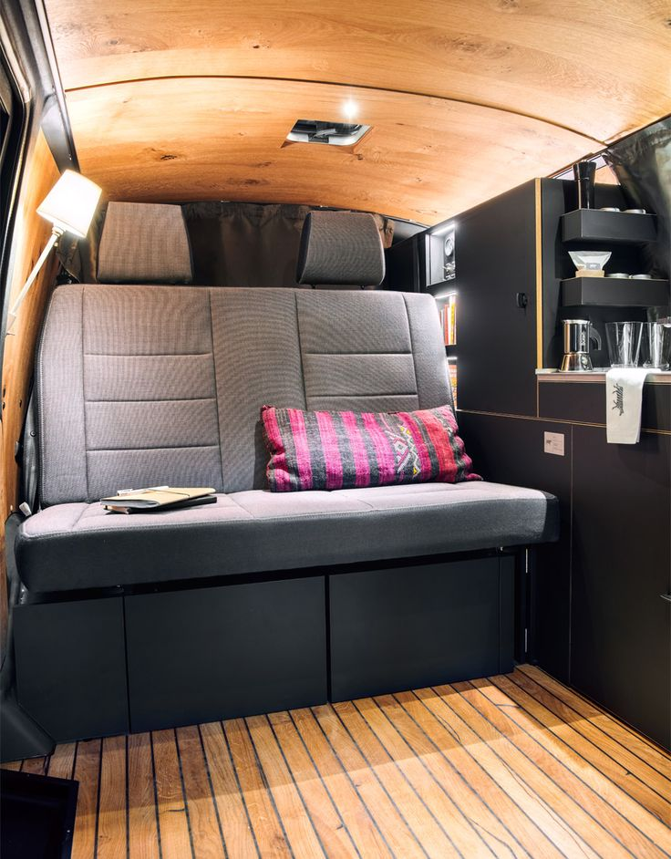 Custombus camper van by Nils Holger Moormaan. Having spent many business trips sleeping in a camper van, the designer wanted to create a comfortable solution that reflected his love of minimal materials and design.